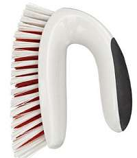 A common house brush used as a dog hair remover.