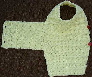 laid out view of one piece crocheted dog sweater.