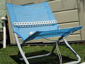 A simple lawn chair can be turned into a pool ramp for dogs.