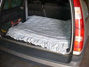 A fluffy quilt can be folded to provide your dog comfort in the back of a vehicle