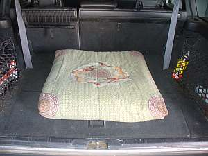 Dog bed made from an old quilt stuffed with foam